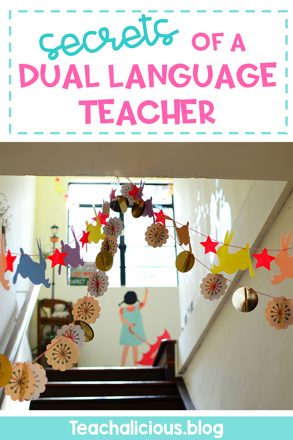 """Going upstairs in a school with decorations on the ceiling with text"""" Secrets of a dual language teacher"""""""